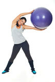 Happy woman doing exercise with pilates ball Stock Photos