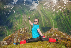 Happy Woman doing exercise on the top of mountain Royalty Free Stock Photography