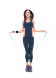 Happy woman doing exercises with jumping rope royalty free stock images