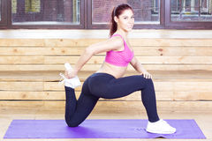 Happy woman doing exercises on your feet. Fitness concept. Stock Photo
