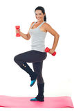 Happy woman doing fitness with barbell Stock Photos