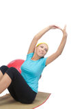 Happy woman doing fitness exercise on mat Royalty Free Stock Photography