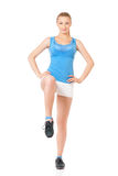Happy woman doing fitness exercise Stock Photos
