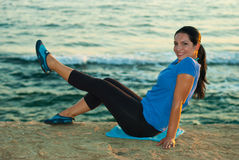 Happy woman doing fitness by sunset Royalty Free Stock Photos