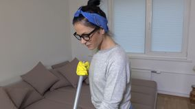 Happy woman doing housework and dancing stock video footage