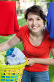 Happy woman doing housework outside Stock Image