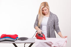 Happy woman doing ironing Stock Photos