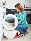 Happy  woman doing laundry with washing machine Royalty Free Stock Photography