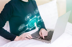 Happy woman doing online shopping at home on bed. Happy woman doing online shopping at home on bed Stock Photo