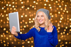 Happy woman doing video call on tablet computer Stock Photos