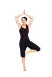 Happy woman doing yoga Stock Image