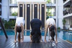 Happy woman doing yoga exercises stock image