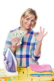 Happy woman with dollars and iron showing okey Royalty Free Stock Photography