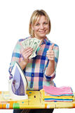 Happy woman with dollars and iron showing thumb up Stock Image