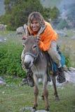 Happy woman on donkey Royalty Free Stock Image