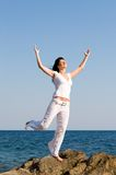 Happy woman dreams to fly on winds Stock Photos