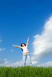 Happy woman dreams to fly on winds Royalty Free Stock Photo