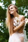 Happy woman in dress among green trees Royalty Free Stock Photography