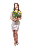 Happy woman in dress with yellow tulips isolated on white background Royalty Free Stock Image