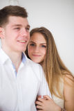 Happy woman dressed in  shirt put her head on shoulder of man Royalty Free Stock Photos