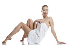 Happy woman dressed in a towel Royalty Free Stock Images