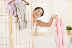 Happy woman dressing up Stock Photo