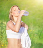 Happy woman drink water Royalty Free Stock Image