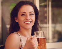 Happy woman drinking beer in pab. Closeup Stock Photography