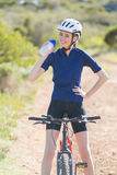 Happy woman drinking after biking Royalty Free Stock Photography