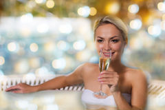Happy woman drinking champagne at swimming pool Royalty Free Stock Photography