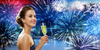Happy woman drinking champagne wine over firework Royalty Free Stock Photos