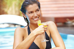 Happy woman drinking cocktail Stock Images