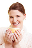 Happy woman drinking coffee Royalty Free Stock Image