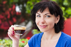 Happy woman drinking coffee Stock Photo