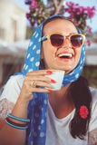 Happy woman drinking coffee In a cafe outdoors Royalty Free Stock Photography