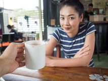 Happy woman drinking coffee in coffee cafe. royalty free stock images