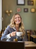 Happy Woman Drinking Coffee At Coffeeshop Stock Image