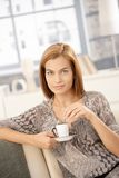 Happy woman drinking coffee at home Stock Photos