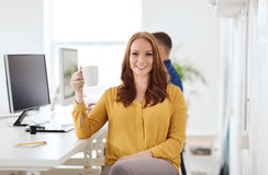 Happy woman drinking coffee or tea at office Stock Image