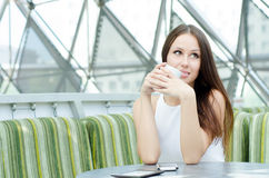 Happy woman drinking first cup of coffee Royalty Free Stock Photography