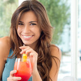 Happy Woman Drinking Juice Stock Image