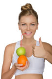 Happy woman drinking juice from fruits Stock Photography