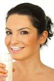 Happy woman drinking milk