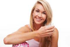 Happy woman drinking milk Stock Image