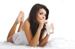 Happy woman drinking milk Stock Photo