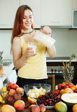 Happy woman drinking milk cocktail with fruits Royalty Free Stock Photos