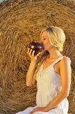 Happy woman drinking milk from cruse or crock Royalty Free Stock Photography
