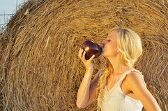 Happy woman drinking milk from cruse or crock Stock Photography