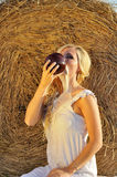 Happy woman drinking milk from cruse or crock Royalty Free Stock Image