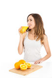 Happy woman drinking orange juice Stock Image